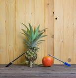 Pen-Pineapple-Apple-Pen on wooden background. Royalty Free Stock Photo