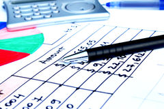Pen placed over financial statistics and charts. Business concept Royalty Free Stock Photos