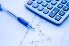 Pen placed over financial statistics and charts Royalty Free Stock Photography