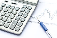 Pen placed over financial statistics and charts Royalty Free Stock Photo