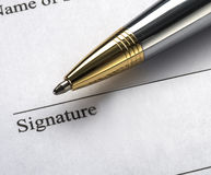 Pen. Placed on signature line Stock Image