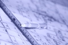 Pen and plan. A pen and a tapeline on a architects plan Royalty Free Stock Photo