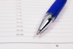 Pen on the planner. Closeup Royalty Free Stock Images