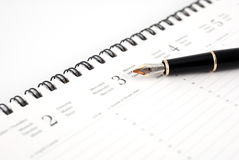 Pen and Planner Royalty Free Stock Image