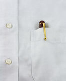 Pen in Pocket. A gold and wooden pen in a shirt pocket Stock Photos