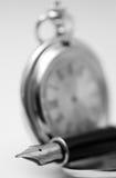 Pen and pocket watch Stock Photos