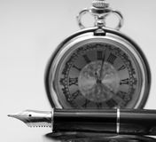 Pen and pocket watch Royalty Free Stock Images