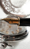 Pen and pocket watch Stock Photography