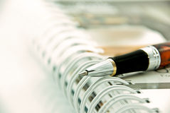 Pen point on organizer Royalty Free Stock Photography