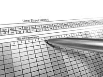 Pen point on the time sheet report royalty free stock photos