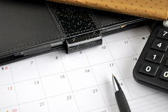 Pen point to date on calendar Royalty Free Stock Image