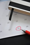 Pen Point to Date 28 on Calendar. Red pen point to date 28 on calendar Stock Photography