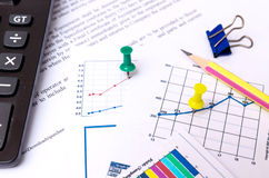 Pen point to graph document Stock Photo