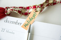 Pen point to holiday note Royalty Free Stock Images