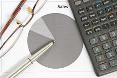 Pen Pointing at Sales Chart. With Calculator Royalty Free Stock Photo