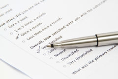 Pen Pointing at Survey and Questionnaire Form Royalty Free Stock Images