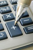 The pen pointing to the add button. In the calculator Stock Photography