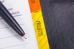 Pen pointing to Projects book-stop. stock photo
