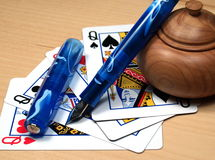 Pen poker. Blue fontain pen and queen poker stock image