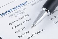 Pen on the portfolio investment Stock Photos