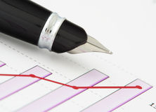 Pen on positive earning chart Royalty Free Stock Photos