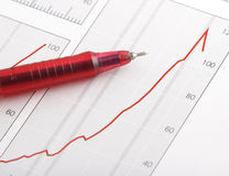 Pen on positive earning chart. (focus on the tip of the pen Stock Image