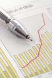 Pen on Positive Earning Graph. (focus on the tip of the pen Royalty Free Stock Images