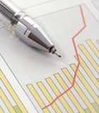Pen on Positive Earning Graph Stock Photo