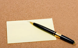 Pen in post-it Stock Image