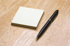 Pen and Post It Notes Pad Stock Photo