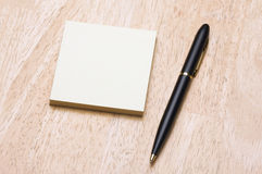 Pen and Post It Notes Pad Stock Photos