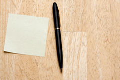 Pen and Post It Notes Pad Royalty Free Stock Images