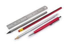 Pen, potloden en het meten van heerser in duim royalty-vrije stock afbeeldingen