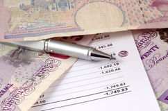 Pen and pounds. Mixture of pen, pounds and statement Stock Photography
