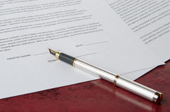 Pen prepared to sign a paper Stock Images