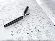 Pen and a process diagram Stock Images