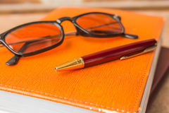 Pen put on the books Royalty Free Stock Photo