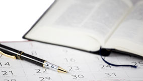The pen put on calendar Royalty Free Stock Image
