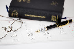 The pen put on calendar. With the bible Stock Photography