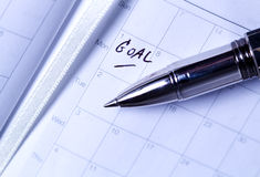Pen put on diary with GOAL letter Stock Photography