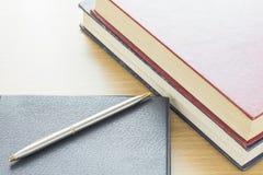 Pen put on notebook Stock Photos