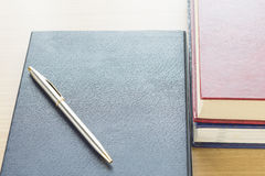 Pen put on notebook Stock Image