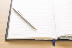 Pen put on notebook open blank page Royalty Free Stock Image
