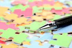 Pen and puzzle Royalty Free Stock Photo