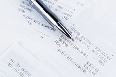 Pen on receipts Royalty Free Stock Image