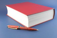 Pen and red book Stock Images