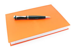 Pen on  red notebook Royalty Free Stock Photo