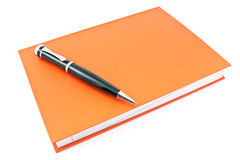 Pen on  red notebook Stock Images