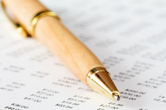 Pen on a report with many digits Royalty Free Stock Photo