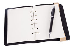 Pen resting on a blank note pad Stock Images